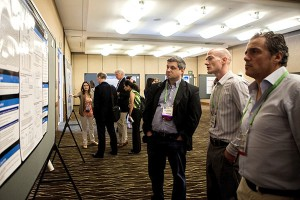 Eric Lutz, PhD (middle, foreground) describes his 2013 Career Development Award project to attendees while Yuliya Pylayeva-Gupta, PhD (background, left) explains her work funded by a 2013 Pathway to Leadership Grant. Photo ©2014 AACR/Todd Buchanan