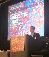 Pancreatic cancer survivor Robb Lamont speaks at the opening plenary session of the meeting.