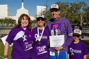 Dr. Nicholas Nissen (top fundraiser) with his son, Gabriel, and, from left, Judy Fischer (third top fundraiser) and Alma Gomez (second top fundraiser) at PurpleStride Los Angeles.  Dr. Nissen's team, the Cedars-Sinai Whipplers, raised more than $38,000 for PurpleStride Los Angeles. The Whipplers were the top fundraising team on event day, and Dr. Nissen was the top individual fundraiser.