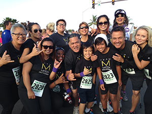 Members of Team Mitch gather in Kona, Hawaii, to support Angus Mitchell, second from right. Mitchell was there to pay tribute to his father, the late Paul Mitchell. Angus Mitchell's mother, Jolina Mitchell (back row, far right), avidly supports the cause, too.