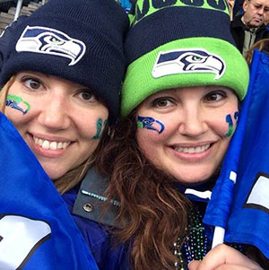 Liz Jurcik (left) and her friend, Hilary, pulling for the Seattle Seahawks during football season. Jurcik is a three-year pancreatic cancer survivor.
