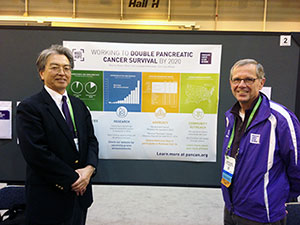 Yoshi Majima of Pancreatic Cancer Action Network Japan with Cincinnati volunteer Maurice Bason at Bason's poster during the Scientist – Survivor Program.