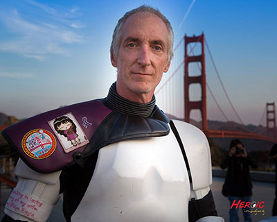 """Star Wars"" enthusiast Kevin Doyle walked 501 miles to the Comic-Con International convention in 2015, dressed as a Stormtrooper to honor his late wife, Eileen, who passed away from pancreatic cancer. Here he is by the Golden Gate Bridge at the end of his walk. He made the northbound crossing accompanied by nearly 100 of his fellow 501st Legion members."