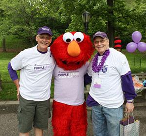 Ralph Cheney (right) and Michael Weinstein flank special guest Elmo at PurpleStride New York City in 2011.
