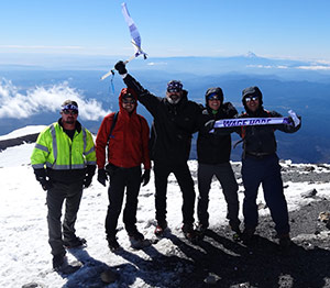 Joe with his nephews and friends summiting Mount Adams.