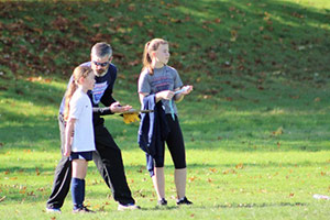 Joe, with two of his daughters, coaching soccer. He has coached girls soccer for 10 years and got back to it this fall.