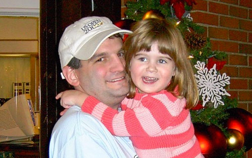 Nikki Cronin as a child hugging her dad, Dennis, who is now a seven-year pancreatic cancer survivor.