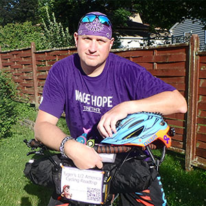 Robert with his bike, to fundraise for pancreatic cancer.