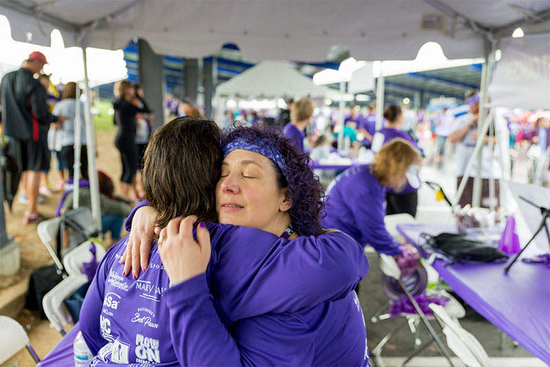 One of several heartfelt moments captured by photographer Alex Harris at PurpleStride Maryland.