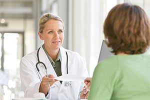 Doctor and patient discuss types of treatment for pancreatic cancer.