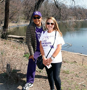 Ron and Camille smiling during a break at PurpleStride New York City in Prospect Park,