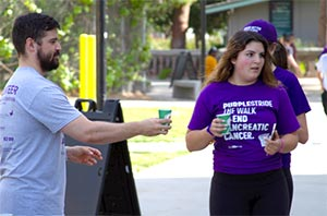 PurpleStride participants stay hydrated during the walk to end pancreatic cancer