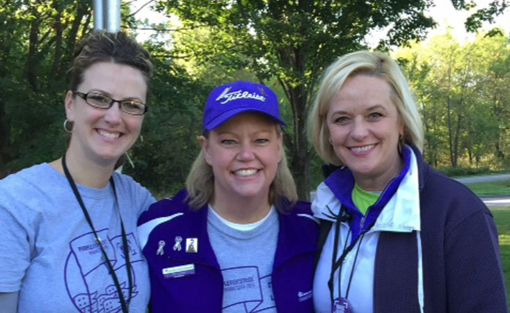 2015-09-19_PurpleRideStride 2015_April Johnson_Teri Larson_Lisa Beckendorf: Lymphoma survivor Teri Larson gathers with fellow volunteers at pancreatic cancer event