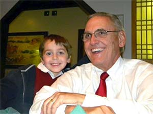 A young boy smiles with his grandfather who passed away from pancreatic cancer