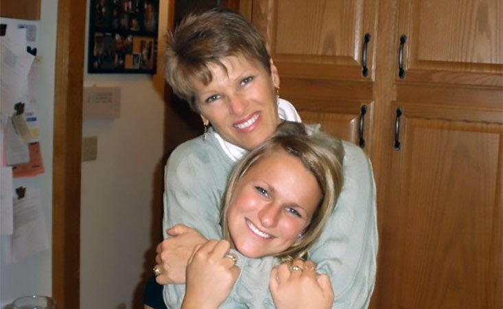 Mother with pancreatic cancer embracing her daughter who took care of her